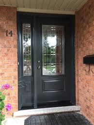 a house from the eighties gets a new front door much more warmer and secure iron ore colour not as stark as black