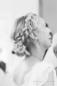 halo braid on the hairline messy bun framed by braid and halo braid on the hairline messy bun framed by braid and fresh flowers bridal