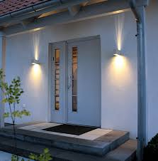 unique outdoor lighting ideas. Adorable Wall Lamp Side Unusual Door Closed Black Doormat On White Floor Plus Green Tree And Electric Switch Right For Modern Outdoor Lighting Unique Ideas I