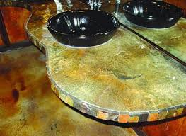 an alternative to a clean edge concrete countertop this contractor added decorative elements to the