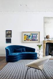 Modern white living room furniture Massive Modern White Living Room With Curved Blue Sofa Pulehu Pizza Modern Living Room Ideas House Garden