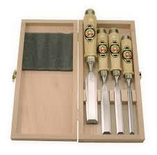 set of four chisels wood box