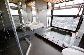 modern bathroom with large tile 700x464 luxury bathrooms with spas touch blog spa bathroom