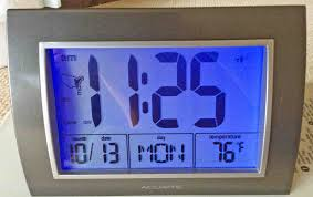 picture of the model 13131 digital atomic clock from acu rite with its backlight energized
