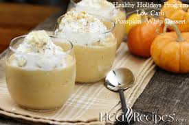 thanksgiving holiday low carb pumpkin whip dessert with whipped cream and mini pumpkins