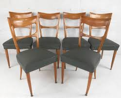 this set of six sculpted back dining chairs feature wonderful curved backs as well as mid century