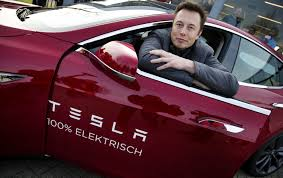 epa04049808 elon musk co founder and ceo of tesla poses with a model