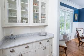 view through the butlers pantry into the adjacent dining area, where the  white painted,