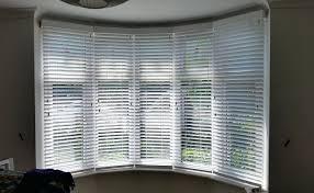 50mm haze faux wood venetian blind fitted in bay window