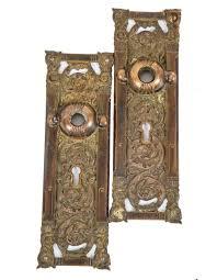 two matching original highly desirable ornamental cast bronze columbian pattern interior residential passage door
