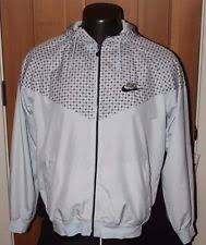 nike 05553. nike hooded jacket size large rn#56323 ca#05553 zips front and back gray 05553 r