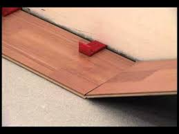 how to lay wood laminate flooring video