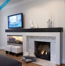 A silver vein cut travertine tiled fireplace surrounding area with a white  mantel and thick border looks chic in a simple design scheme.