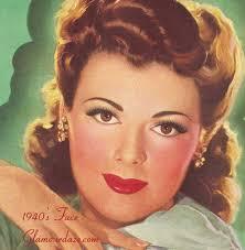 makeup heavy pink dark pink cheeks various shades of red lipsticks very 1940s