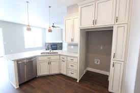 Angled Peninsula Dishwasher On Left Small Trash Cabinet On Right