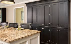 kitchen cabinet hardware for dark cabinets. wall of black inset shaker cabinets with exposed nickel-plated hinge barrels and nickel knobs kitchen cabinet hardware for dark d