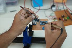Electronic Prototype Design Pin On Soldering Of A Dot Board For Prototype Design