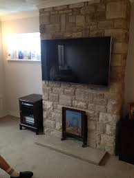 wall mounting of 55 lg tv on portland stone fireplace supply and installation of wall mounting bracket supply of all cabling run inside chimney flu and
