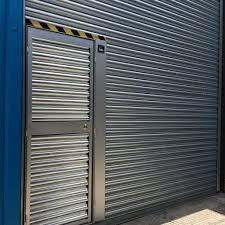 Decorating wicket door images : Roller Shutter with Wicket Door | Harpers Doors Specialists