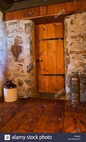 inside door. Medieval Style Wooden Bathroom Door Inside An Old Circa 1850 Cottage Fieldstone Home, Quebec, Canada N
