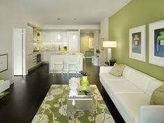 mint green wall paint in living room contemporary with dark wood floor chanel warhol framed prints