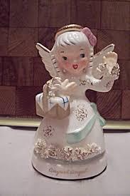 Porcelain August Angel Figurine