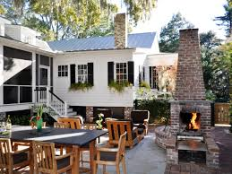 white traditional exterior with brick fireplace