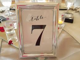 silver frame with black and white table number