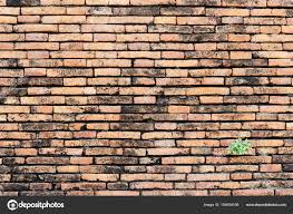 old brick wall diffe sized and red orange and yellow make i stock