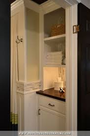 bathroom remodel original linen closet replaced with lower cabinet with open shelves above