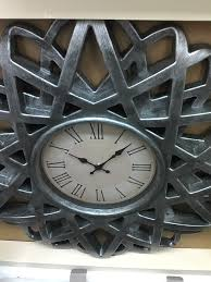 nessa the procrastinator  i liked this clock from burlington coat factory but it ll need a paint job and a new clock face the shape is awesome though