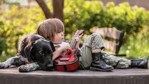 Cute boy playing guitar with dog hd ...