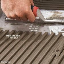 pick a large notched trowel for big tile