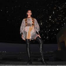 boho style dress and black leather otk boots on blua lipa 2019