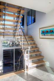 stainless steel stair risers, open stair case, switch back stair case, modern  stair