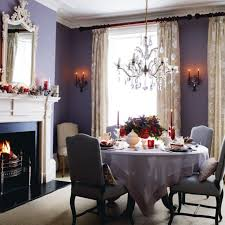 purple dining room color schemes with crystal chandelier and wall mirrors above fireplaces for small spaces