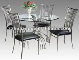 Glass top dining sets Wood Ashley Round Glass Top Steel Dining Table And Dining Chairs Alibaba Ashley Round Glass Top Steel Dining Table And Dining Chairs Buy