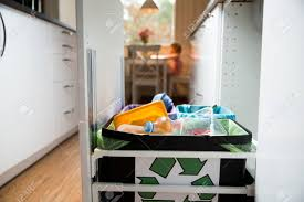 Three Trash Bins With Sorted Garbage In Kitchen Cabinet With Stock