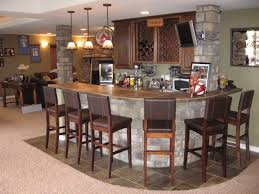 home design rustic gray stones panels round shaped home island bar and chairs also three polished bronze pendant island lighting in traditional basement