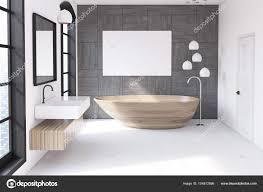 bathroom interior with a gray tiled wall a wooden bathtub a horizontal poster above it and a sink with a mirror 3d rendering mock up photo by