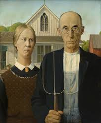 painting of man holding a pitch fork and a woman grant wood
