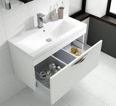 modern bathroom furniture. White Vanity Unit With Open Drawer In A Modern Bathroom Furniture