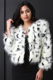 description this stylish jacket features a cozy faux fur with dalmatian
