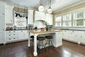 country kitchen with white cabinets country kitchen with white shaker cabinets butcher block island and black