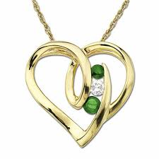 emerald heart pendant in 14k gold with diamond accent
