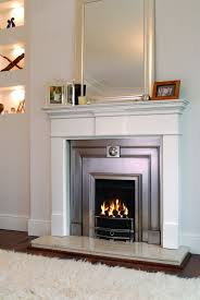 luxurious grey details on gorgeous white electric fireplace for stunning room with silver framed wall mirror on white painted wall facing white carpet rug
