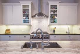example of a large classic l shaped eat in kitchen design in seattle with