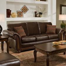decorating brown leather couches. Brown Tones Striped Kilim Sofa Pillows Beneath Leather Couch Decorating Brown Leather Couches