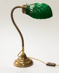 A Vintage Angle Poise Brass Desk Lamp With Shell Shaped Ribbed