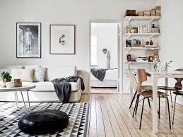 enchanting scandinavian living room interior with white colored sofa and white round shape coffee table
